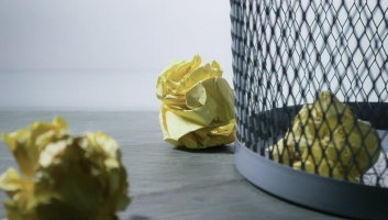 Rubbish bin with paper in it image